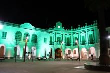 El Ayuntamiento se ha iluminado de verde con motivo del Día contra el Cáncer