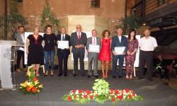 Los homenajeados junto a las autoridades locales