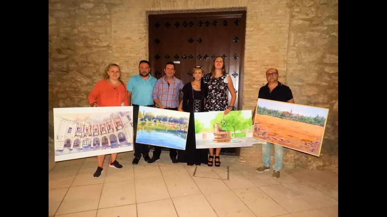 Silvia Cebrián y Juan López de Pablo, junto a los ganadores en el Certamen de Pintura